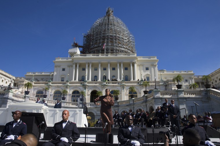 A sign language interpreter signs during a speech by Nation of Islam leader Louis Farrakhan at rally to mark the 20th anniversary of the Million Man March, on Capitol Hill, on Saturday, Oct. 10, 2015, in Washington. (AP Photo/Evan Vucci)