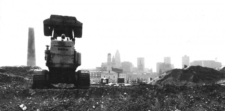 In May 1969, a bulldozer cuts its way through dirt during construction of the new Federal Post Office Building on East Fayatee Street. The neighbor for the post office is the historic Shot Tower. (Baltimore Sun file photo)