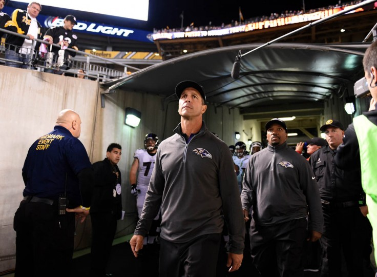 Baltimore Ravens head coach John Harbaugh entering the field prior to the start of the Ravens game against the Steelers at Heinz Field in Pittsburgh. (Kenneth K. Lam/Baltimore Sun)