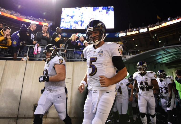 Baltimore Ravens quarterback Joe Flacco entering the field prior to the start of the Ravens game against the Steelers at Heinz Field in Pittsburgh. (Kenneth K. Lam/Baltimore Sun)