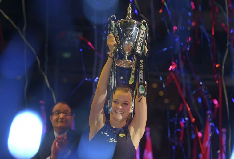 Agnieszka Radwanska of Poland raises her trophy after winning the singles final against Petra Kvitova of Czech Republic at the WTA tennis finals in Singapore Sunday, Nov. 1, 2015. (AP Photo/Joseph Nair)