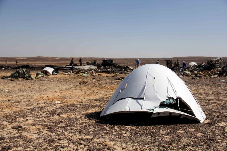 Debris of a Russian airplane is seen at the site a day after the passenger jet bound for St. Petersburg, Russia, crashed in Hassana, Egypt, on Sunday, Nov. 1, 2015. The Metrojet plane, bound for St. Petersburg in Russia, crashed 23 minutes after it took off from Egypt's Red Sea resort of Sharm el-Sheikh on Saturday morning. The 224 people on board, all Russian except for four Ukrainians and one Belarusian, died. (AP Photo)