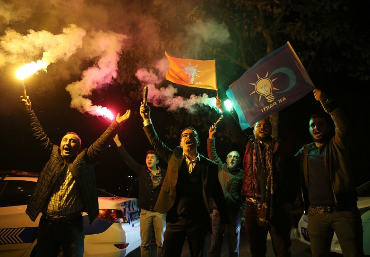 Supporters of Turkey's President Recep Tayyip Erdogan and of The Justice and Development Party, (AKP), celebrate in Istanbul, Sunday, Nov. 1, 2015. Preliminary results in Turkey's parliamentary election suggest that the ruling party has restored its majority in a stunning victory. State-run TRT television reports that with more than 95 percent of the votes counted, the ruling Justice and Development Party, or AKP, has won just above 49 percent, which would comfortably restore its ruling majority. (AP Photo/Hussein Malla)