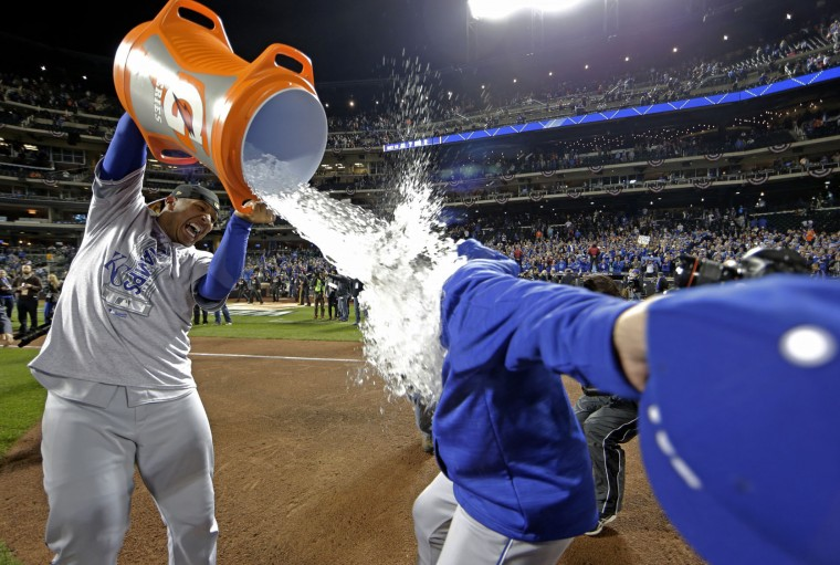 Kansas City Royals' Salvador Perez dunks manager Ned Yost after Game 5 of the Major League Baseball World Series against the New York Mets Monday, Nov. 2, 2015, in New York. The Royals won 7-2 to win the series. (AP Photo/David J. Phillip)