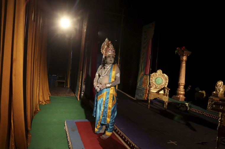 An Indian actor dressed as Rama, the main character of the Hindu epic Ramayana, prepares to perform at a theatre in Bangalore, India, Monday, Nov. 2, 2015. The performance was self-funded by a group of artists who do other jobs for a living. (AP Photo/Aijaz Rahi)