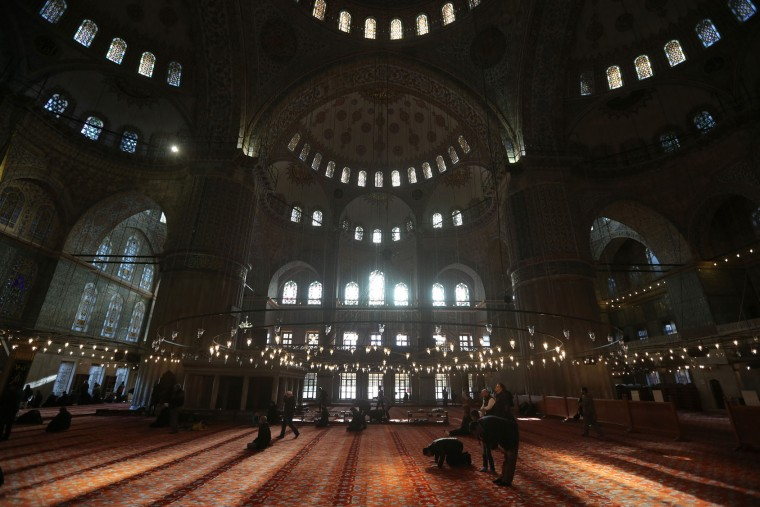Turkish citizens and tourists pray in the iconic Sultan Ahmed Mosque, better known as the Blue Mosque, in the historic Sultanahmet district of Istanbul, Monday Nov. 2, 2015. Turkish President Recep Tayyip Erdogan on Monday hailed a big victory for his ruling party in the country's parliamentary election and demanded the world respect the result. The ruling Justice and Development Party, or AKP, secured a stunning victory in Sunday's snap parliamentary election, sweeping back into single-party rule only five months after losing it. (AP Photo/Hussein Malla)