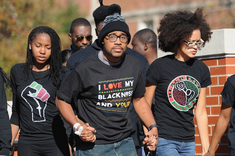 Jonathan Butler, a University of Missouri grad student who did a 7-day hunger strike, is greeted by the crowd of students on the campus of University of Missouri - Columbia on November 9, 2015 in Columbia, Missouri. Students celebrate the resignation of University of Missouri System President Tim Wolfe amid allegations of racism. (Michael B. Thomas/Getty Images)