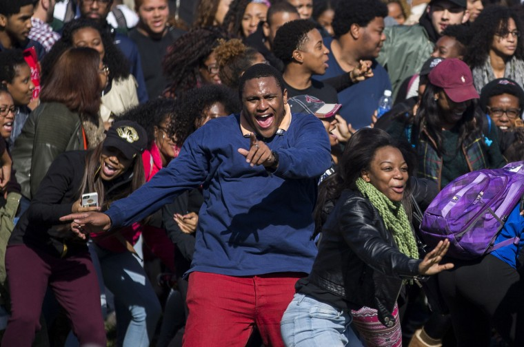 Members of Concerned Student 1950 celebrate after the resignation of University of Missouri president Timothy M. Wolfe on the campus November 9, 2015 in Columbia, Missouri. Wolfe resigned after pressure from students and student athletes over his perceived insensitivity to racism on the university campus. (Brian Davidson/Getty Images)
