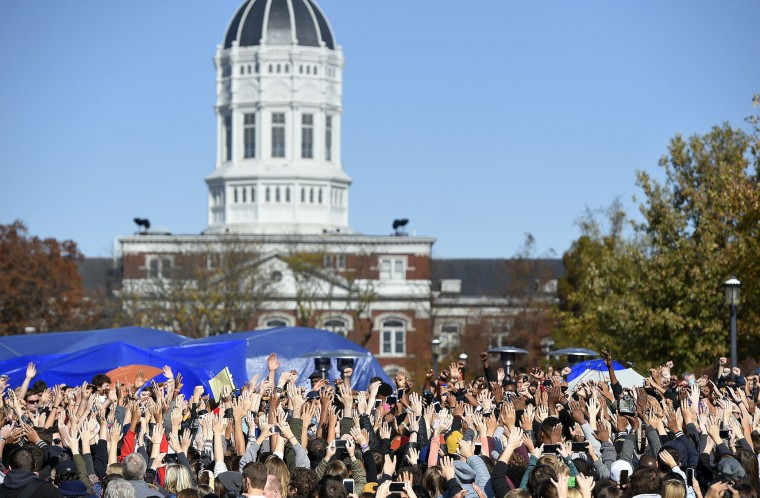 Student protesters on the campus of the University of Missouri in Columbia react to news of the resignation of University of Missouri system President Tim Wolfe on Monday, Nov. 9, 2015. Wolfe resigned under pressure from student protesters who claimed the president had not done enough to address recent racially-motivated incidents on the campus. (David Eulitt/Kansas City Star/TNS)