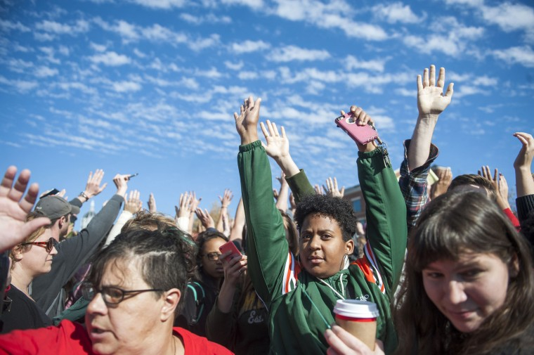 Protesters raise their arms to block media from taking photos during the Concerned Students 1950 protest on Monday, Nov. 9 2015, in Columbia, Mo. Concerned Students 1950 is a group named after the first year that black students were allowed to attend MU. (Michael Cali/San Diego Union-Tribune/TNS)