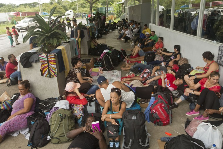 Cuban migrants take a break outside the Costa Rican immigration building at the border with Nicaragua, in Penas Blancas, Costa Rica, Monday, Nov. 16, 2015. More than 1,000 Cuban migrants heading north to the United States tried to cross the border from Costa Rica into Nicaragua, causing tensions to soar between the neighbors as Nicaraguan security forces sought to turn them back. Following the thaw in relations between Washington and Havana, some Cubans have been making their way to Central America in hopes of then heading through Mexico and into the United States. (AP Photo/Esteban Felix)