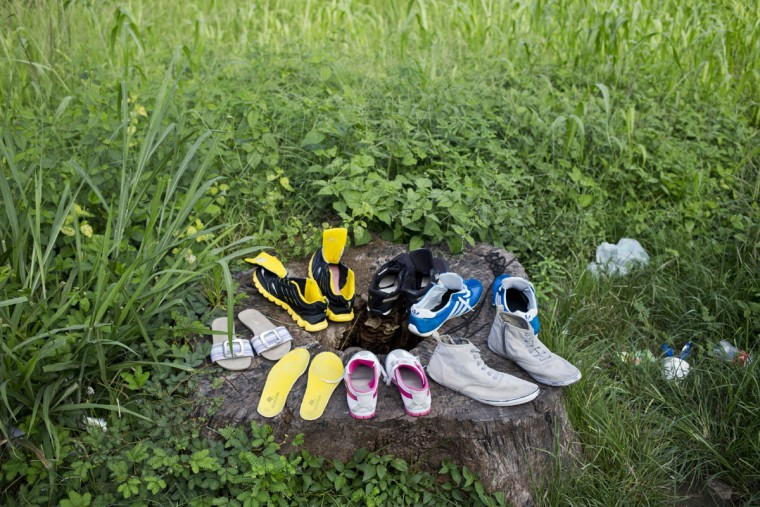 Shoes, belonging to Cuban migrants, air-dry on a tree trunk near the immigration office in PeÒas Blancas, Costa Rica, Tuesday, Nov. 17, 2015. Cuban officials blamed the United States late Tuesday for instigating a surge in the number of Cuban migrants attempting to reach the U.S. through Central America amid ongoing efforts to normalize relations between the former Cold War foes. (AP Photo/Esteban Felix)