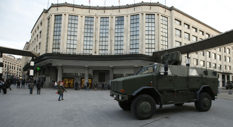 A Belgian army armoured vehicle stands parked in front of the central railway station in Brussels, Monday, Nov. 23, 2015. Three days of the highest terror alert and unprecedented measures that have closed down the city's subways, schools and main stores, has created a very different atmosphere as the Belgian capital tries to avoid attacks similar to the ones that caused devastating carnage in Paris. (AP Photo/Alastair Grant)