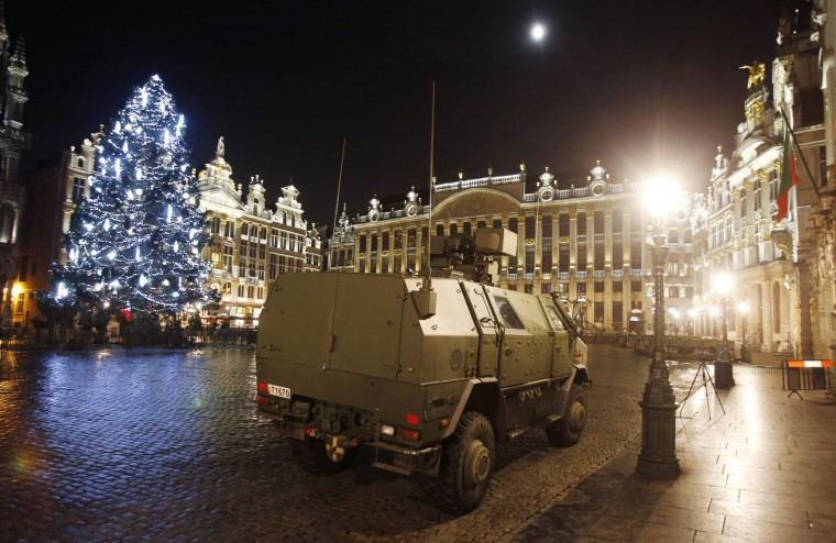 A police vehicle is parked at the Grand Place in downtown Brussels, Belgium, Monday, Nov. 23, 2015. The Belgian capital Brussels has entered its third day of lockdown, with schools and underground transport shut and more than 1,000 security personnel deployed across the country. (AP Photo/Michael Probst)