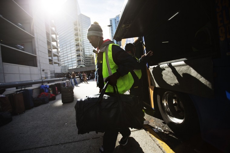 A worker unloads bags off a bus from Washington as it arrives ahead of the Thanksgiving holiday Tuesday, Nov. 24, 2015, in Atlanta. A stronger economy and lower gas prices mean Thanksgiving travelers can expect more congested highways this year. During the long holiday weekend, 46.9 million Americans are expected to go 50 miles or more from home, the highest number since 2007, according to travel agency and car lobbying group AAA. (AP Photo/David Goldman)