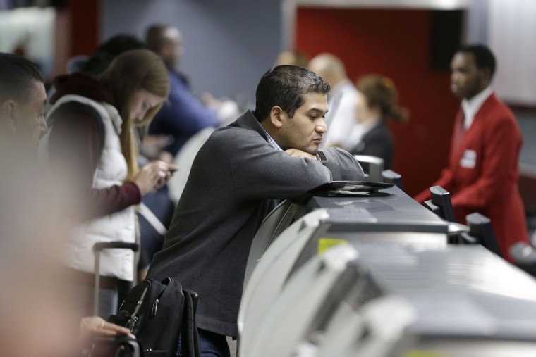 Travelers check-in to their flights at LaGuardia Airport in New York, Tuesday, Nov. 24, 2015. (AP Photo/Seth Wenig)