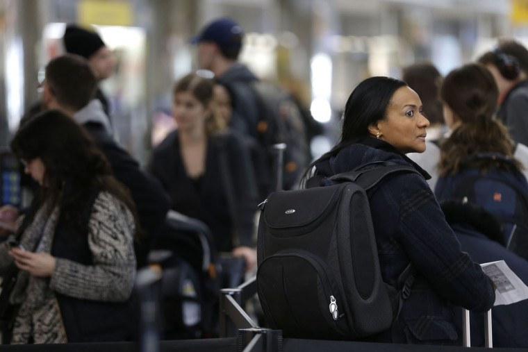 Travelers wait in line to check-in to their flights at LaGuardia Airport in New York, Tuesday, Nov. 24, 2015. An estimated 46.9 million Americans are expected to take a car, plane, bus or train at least 50 miles from home over the long holiday weekend, according to the motoring organization AAA. (AP Photo/Seth Wenig)