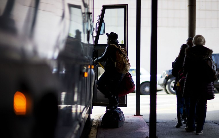 Passengers board a bus ahead of the Thanksgiving holiday at a Greyhound station Tuesday, Nov. 24, 2015, in Atlanta. An estimated 46.9 million Americans are expected to take a car, plane, bus or train at least 50 miles from home over the long holiday weekend, according to the motoring organization AAA. That would be an increase of more than 300,000 people over last year, and the most travelers since 2007. (AP Photo/David Goldman)