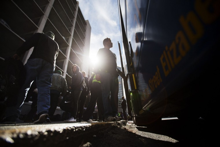 Passengers disembark off a bus arriving from Washington ahead of the Thanksgiving holiday Tuesday, Nov. 24, 2015, in Atlanta. An estimated 46.9 million Americans are expected to take a car, plane, bus or train at least 50 miles from home over the long holiday weekend, according to the motoring organization AAA. That would be an increase of more than 300,000 people over last year, and the most travelers since 2007. (AP Photo/David Goldman)