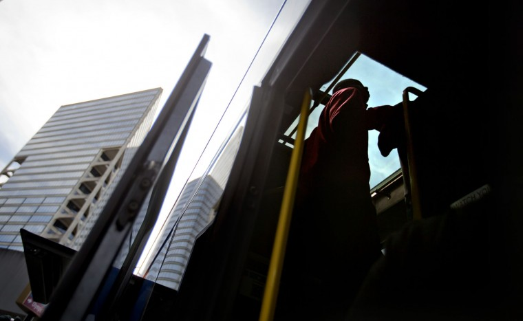 A passenger looks for seat on the upper deck of a bus heading to New Orleans ahead of the Thanksgiving holiday Tuesday, Nov. 24, 2015, in Atlanta. An estimated 46.9 million Americans are expected to take a car, plane, bus or train at least 50 miles from home over the long holiday weekend, according to the motoring organization AAA. That would be an increase of more than 300,000 people over last year, and the most travelers since 2007. (AP Photo/David Goldman)