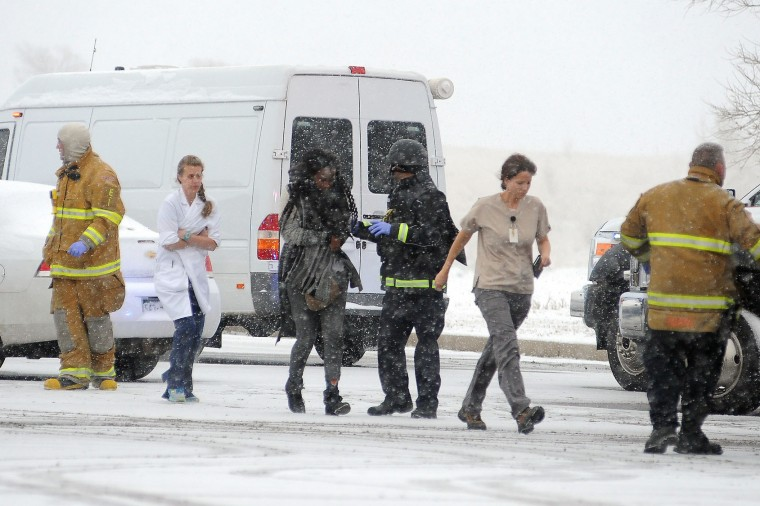 People are escorted away after a deadly shooting at a Planned Parenthood clinic Friday, Nov. 27, 2015, in Colorado Springs, Colo. A gunman opened fire at the clinic on Friday, authorities said, wounding multiple people. (Daniel Owen/The Gazette via AP)