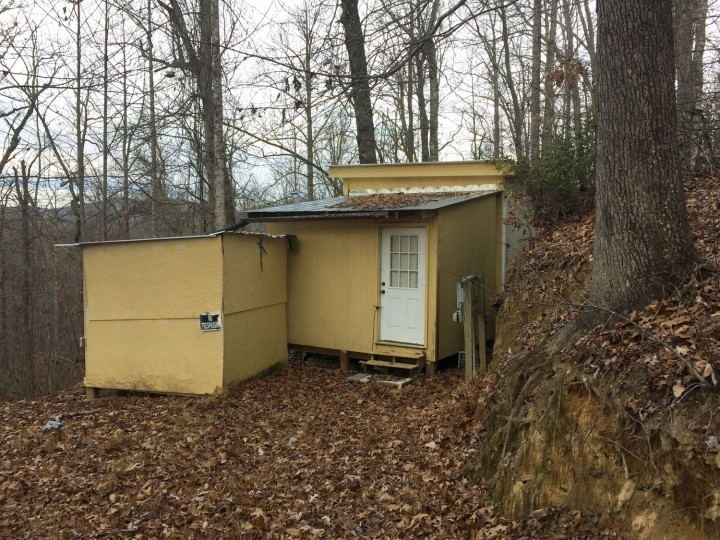 A small shack with no electricity or running water where where Planned Parenthood clinic shooting suspect Robert Lewis Dear spent time, is shown Saturday, Nov. 28, 2015, about a half-mile up a twisty dirt road near Black Mountain, N.C. North Carolina neighbors of Dear say he was quiet and when he did speak, he didn't appeared to be all there. Neighbors also say he didn't talk about religion or abortion. Dear also spent time in a trailer in the nearby town of Swannanoa. (AP Photo/Michael Biesecker)