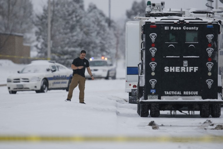 Police investigate at a Planned Parenthood clinic and area around the building north of a strip mall early Saturday, Nov. 28, 2015, in northwest Colorado Springs, Colo. A gunman who opened fire inside a Planned Parenthood clinic was arrested Friday after engaging in gun battles with authorities during an hourslong standoff that killed three people and wounded nine others, officials said. (AP Photo/David Zalubowski)