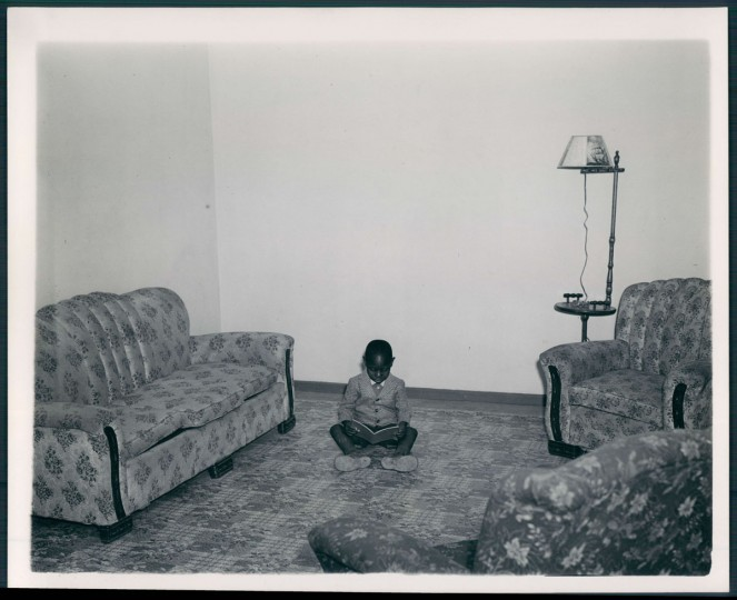 A boy sits in his living room in a Cherry Hill housing project on May 4, 1946. (Baltimore Sun photo by Ellis Malashuk)