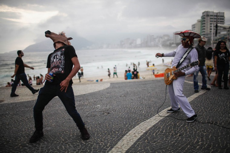 Revelers celebrate along Ipanema beach during Day of the Dead festivities on November 2, 2015 in Rio de Janeiro, Brazil. Brazilians often mark the traditional Mexican holiday by visiting loved ones' graves and sometimes leaving offerings of food or drink. Many revelers came to Ipanema beach during a 'Zombie Walk'. (Mario Tama/Getty Images)