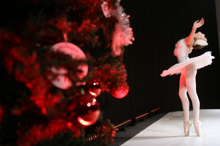 A ballerina performs near a Christmas tree at a gathering of volunteer student Santas and angels on November 28, 2015 in Berlin, Germany. (Photo by Adam Berry/Getty Images)