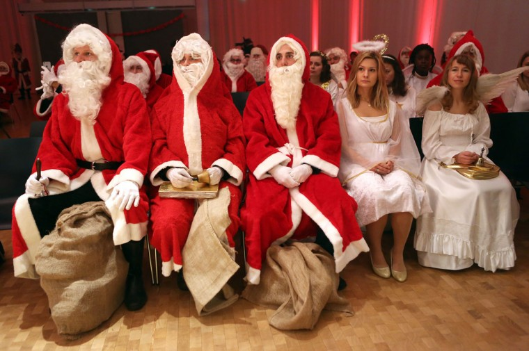 University students dressed as Santa Claus and Christmas angels attend a gathering of volunteer student Santas and angels on November 28, 2015 in Berlin, Germany. (Photo by Adam Berry/Getty Images)