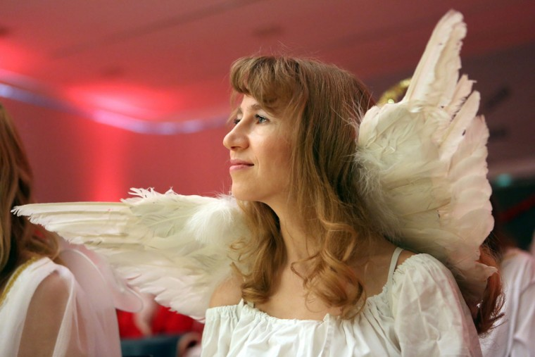 An participant dressed as a Christmas angel attends a gathering of volunteer student Santas and angels on November 28, 2015 in Berlin, Germany. (Photo by Adam Berry/Getty Images)