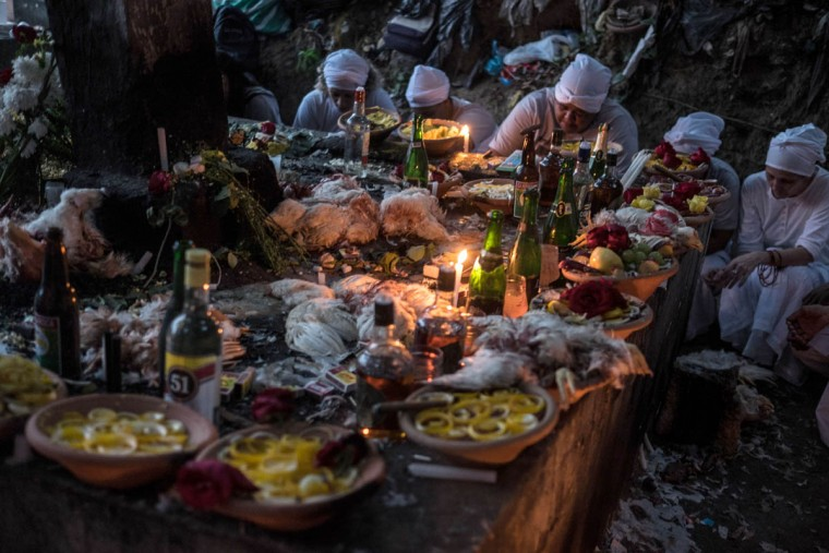 Faithful participate in a candomble ritual of the African Brazilian religion at Botafogo cemetery in Rio de Janeiro, Brazil on November 2, 2015 during the Day of the Dead. (Christophe Simon/Getty Images)