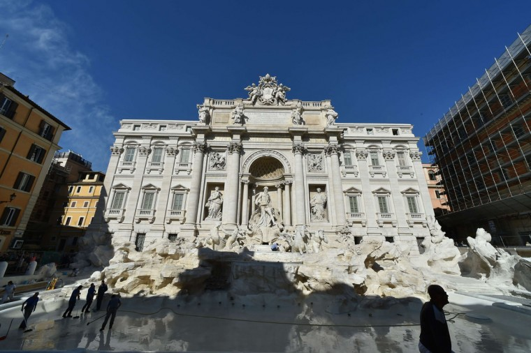 Workers clean the restored Trevi fountain prior its inauguration on November 3, 2015 in central Rome. (ALBERTO PIZZOLI/AFP/Getty Images)