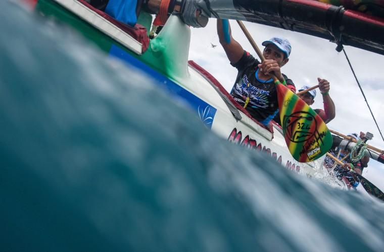 Participants exit the Raiatea pass during the first leg of the Hawaiki Nui Va'a 2015 outrigger canoe race on the morning of November 4, 2015, after more than 4 hours of rowing. The Hawaiki Nui Va'a outrigger canoe race is an annual event with more than 100 team of intense racing between Huahine, Raiatea, Taha'a and Bora Bora, honoring an ancient sport with great cultural values. The 24th edition of the race hosts teams from Taihiti, France and New Zealand, with the number of teams and countries increasing each year. Originally made in wood, almost all of the canoes are today fabricated with high tech polyester material and carbon fiber. (GREGORY BOISSY/AFP/Getty Images)