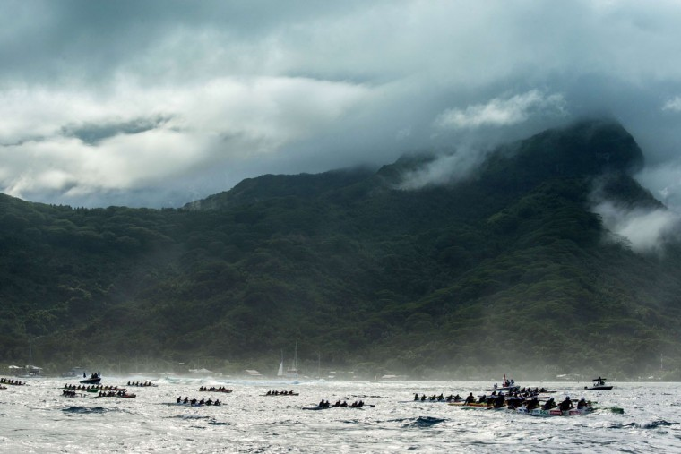Participants exit the Huahine pass in the direction of Raiatea on the morning of November 4, 2015 for the first leg of the Hawaiki Nui Va'a 2015 outrigger canoe race. The Hawaiki Nui Va'a outrigger canoe race is an annual event with more than 100 team of intense racing between Huahine, Raiatea, Taha'a and Bora Bora, honoring an ancient sport with great cultural values. The 24th edition of the race hosts teams from Taihiti, France and New Zealand, with the number of teams and countries increasing each year. Originally made in wood, almost all of the canoes are today fabricated with high tech polyester material and carbon fiber. (GREGORY BOISSY/AFP/Getty Images)