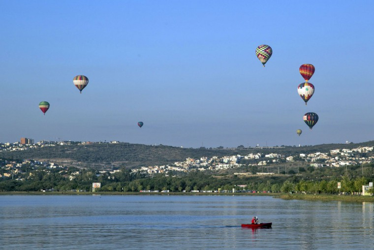 Hot air balloons fly during the International Balloon Festival at the Metropolitan Park in Leon, Guanajuato state, Mexico on November 13, 2015. (HECTOR GUERRERO/AFP/Getty Images)