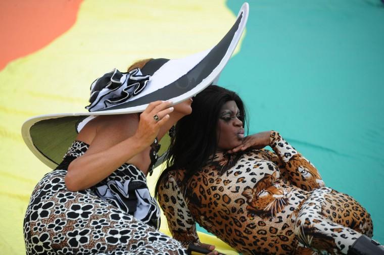 People take part in an LGBT Pride parade along Copacabana beach in Rio de Janeiro, Brazil, on November 15, 2015. (TASSO MARCELO/AFP/Getty)