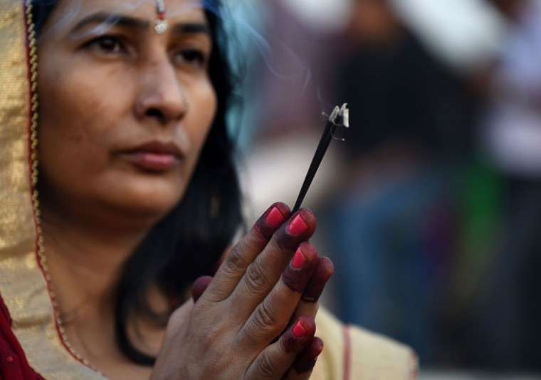 Indian Hindu devotees offer prayers during the Chhat festival on the banks of the river Yamuna in New Delhi on November 17, 2015. Chhath festival, also known as Surya Pooja (worship of the sun), is observed in eastern parts of India where homage is paid to the sun and water Gods eight days after Diwali, the festival of lights. During Chhath festival, devotees undergo a fast and offer water and milk to the Sun God at dawn and dusk. (AFP Photo/Sajjad Hussain)