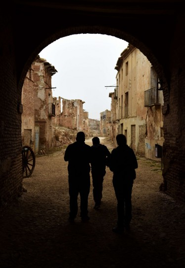 People stand under an arch in the ruins of Belchite village, in Aragon on November 12, 2015. (GERARD JULIEN/AFP/Getty Images)