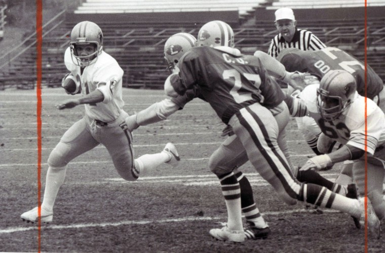 Calvert Hall's John Johnson runs wide for 2 yards and Cards' first touchdown in the first quarter, eluding Loyola's Todd DeMario (27). (George H. Cook/Baltimore Sun, 1978)