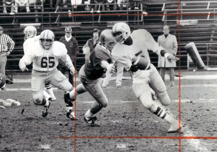 Loyola quarterback Bernie Bowers eludes Calvert Hall tackle for second-quarter gain. (Joseph A. DiPaola/Baltimore Sun, 1977)