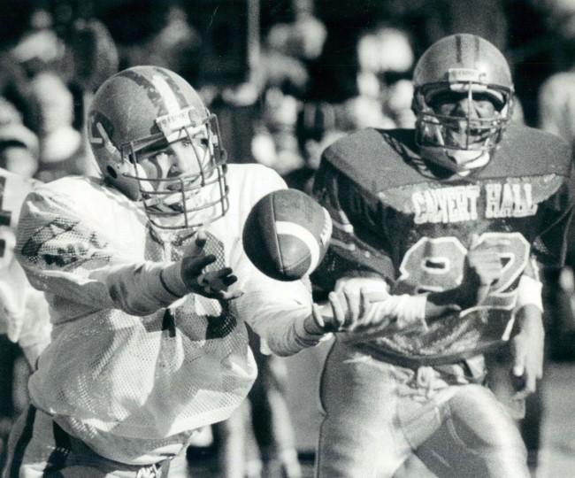 Loyola's Aaron Reinhart dives for a long pass and Calvert Hall's Roland Brown follows. (Baltimore Sun archives, 1988)