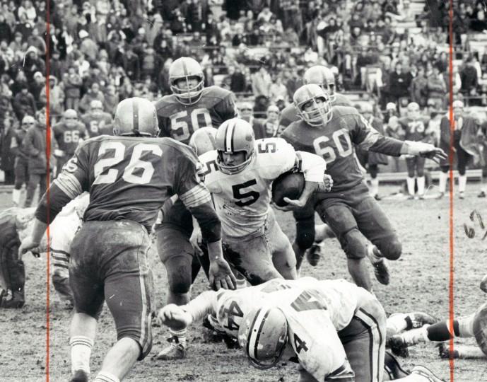 Loyola quarterback Dan Dullea plunges for five-yard gain in second period. (Joseph A. DiPaola/Baltimore Sun, 1971)