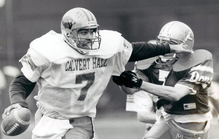 Calvert Hall's Luther Alexander, left, is trying to escape the grip of Loyola's Colin Brune in the first quarter. (Kenneth K. Lam/Baltimore Sun, 1991)