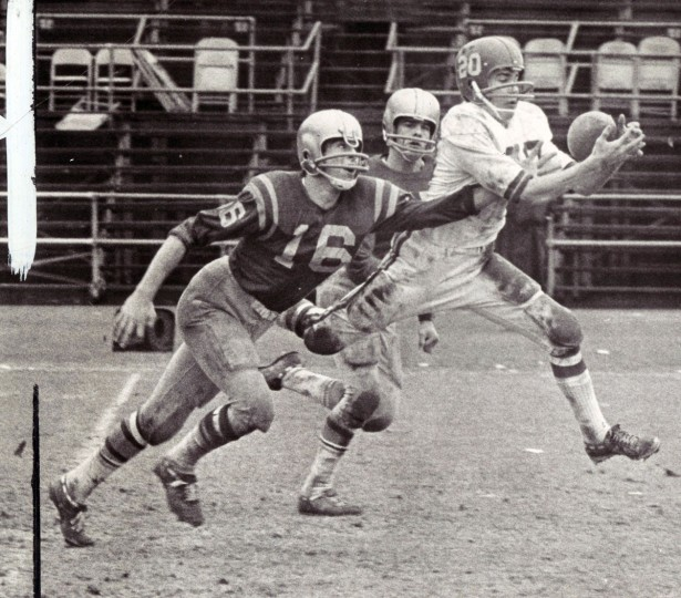Nick Christhif makes a neat defensive play for Loyola to thwart pass to Calvert Hall wingback Mike Kelly. (Paul Hutchins/Baltimore Sun, 1967)
