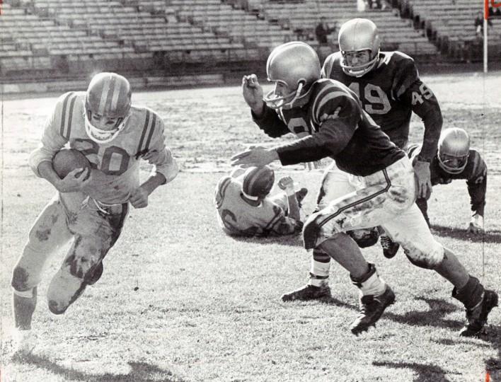 Ken Harms turns end for good gain for Calvert Hall against Loyola. (Paul Hutchins/Baltimore Sun, 1964)