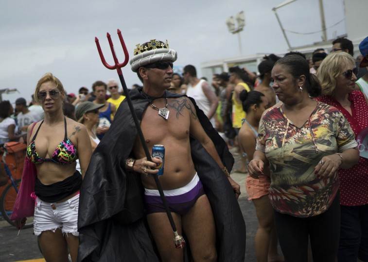 A man participates in the Gay Pride Parade at Copacabana beach, in Rio de Janeiro, Brazil, Sunday, Nov. 15, 2015. (AP Photo/Leo Correa)