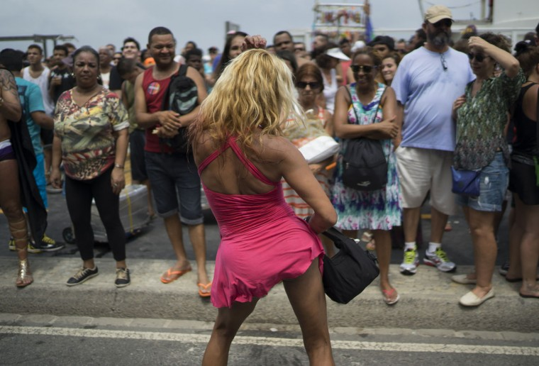 A man dances during the Gay Pride Parade at Copacabana beach, in Rio de Janeiro, Brazil, Sunday, Nov. 15, 2015. (AP Photo/Leo Correa)