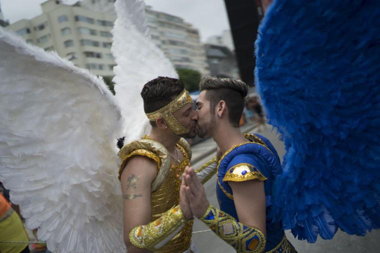 Two men kiss during the Gay Pride Parade at Copacabana beach, in Rio de Janeiro, Brazil, Sunday, Nov. 15, 2015. (AP Photo/Leo Correa)
